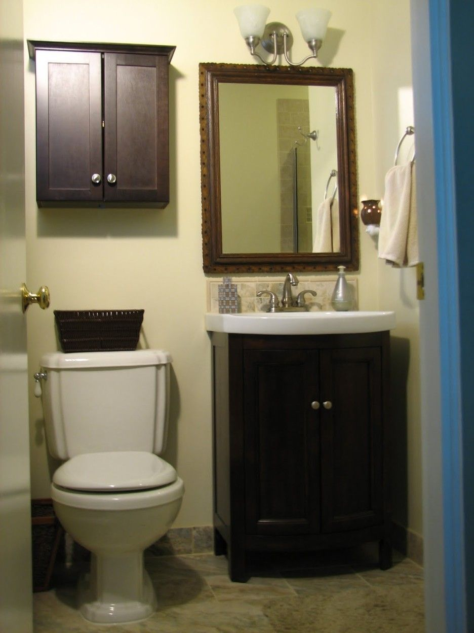 Bathroom Small Dark Brown Wooden Cabinet With Double Doors pertaining to measurements 936 X 1248